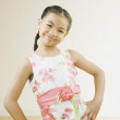 Portrait of Pacific Islander girl with hands on hips — Stock Photo