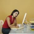 Businesswoman working at her desk — Stock Photo #13237425