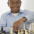 Stock Photo: African boy playing chess
