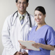 Royalty-Free Stock Photo: Portrait of Hispanic male doctor and nurse holding file