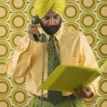 Businessman wearing turban talking on telephone — Stock Photo