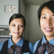 Portrait of two female flight attendants - Stockfoto