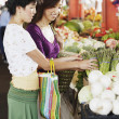 Two women shopping for produce — Stock Photo