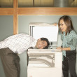 Businesswoman photocopying colleague's head — Stock Photo