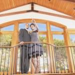 Couple on balcony in house — Stock Photo