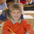 Portrait of boy working at desk in classroom — ストック写真