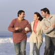 Hispanic friends walking on beach — Stock Photo