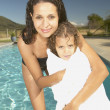 Mother holding daughter wrapped in towel — Stock Photo
