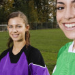 Portrait of girls on soccer field — Stock Photo