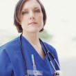 Female nurse outdoors — Stock Photo