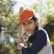 Hispanic girl with baseball bat — Stock Photo