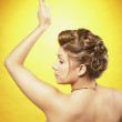Portuguese woman with hair up and arm raised — Stock Photo