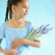 Girl holding flowers — Stock Photo