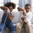 Stock Photo: AfricAmericsister and brother playing video games
