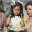 Young girl eating pasta - Stock Photo