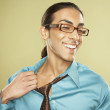 Middle Eastern businessman pulling off necktie — Stock Photo