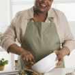 Senior woman making cookies — Stock Photo