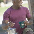 Man making coffee while camping — Stock Photo