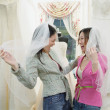 Young women wearing veils in a bridal boutique — Stock Photo