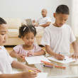 Stock Photo: Indian siblings coloring at table