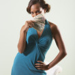 Stock Photo: Young woman fanning herself with cash