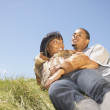 Foto de Stock  : Couple laying on grass together