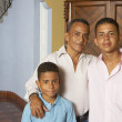 Hispanic father and sons hugging — Stock Photo