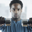 Portrait of man lifting weights — Stock Photo