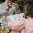 Hispanic father video recording daughter on Christmas — Stock Photo #13237985
