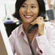 Asian businesswoman talking on telephone — Stock Photo