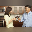 Young couple toasting each other with wine — Foto Stock