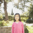 Stock Photo: Young Asigirl standing in sunlight