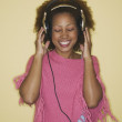 Stock Photo: Young woman enjoying music
