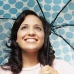 African woman under umbrella — Stock Photo