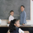 School children and teacher in class — Foto Stock
