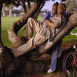 Couple relaxing in tree — Stock Photo