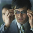 Stock Photo: South Americbusinessmwearing eyeglasses