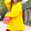 Stock Photo: Portrait of womwearing raincoat