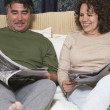 Senior Hispanic couple reading newspaper — Stock Photo