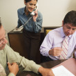 Stock Photo: Business professionals reviewing paperwork