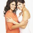 Stock Photo: Portrait of Hispanic adult sisters hugging