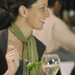 Profile of woman eating salad in restaurant — Stock Photo