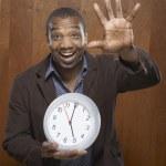 Portrait of man holding clock — Stock Photo