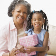 African grandmother and granddaughter hugging — Stock Photo