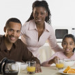 Stock Photo: Portrait of family at breakfast table
