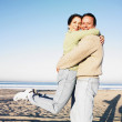 Hispanic couple hugging at beach — Stock Photo #13238428