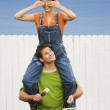 Woman sitting on boyfriend's shoulders — Stock Photo