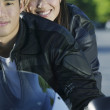 Couple riding a motorcycle — Stock Photo #13238479
