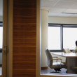 Businessmen working in separate offices — 图库照片
