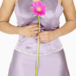 Stock Photo: Midsection of womholding flower